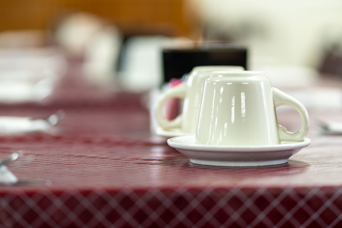 Empty coffee cups await customers at Tiffany's Restaurant in Topeka, Indiana.