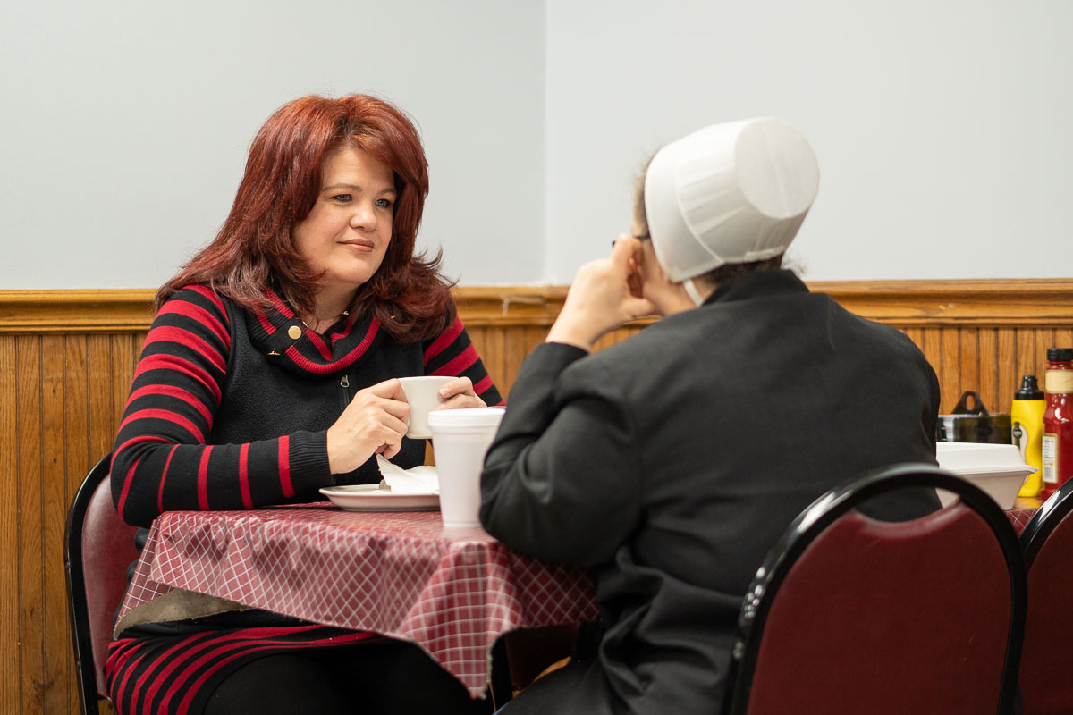 Two women share lunch and friendly conversation at Tiffany's Restaurant in Topeka, Indiana.