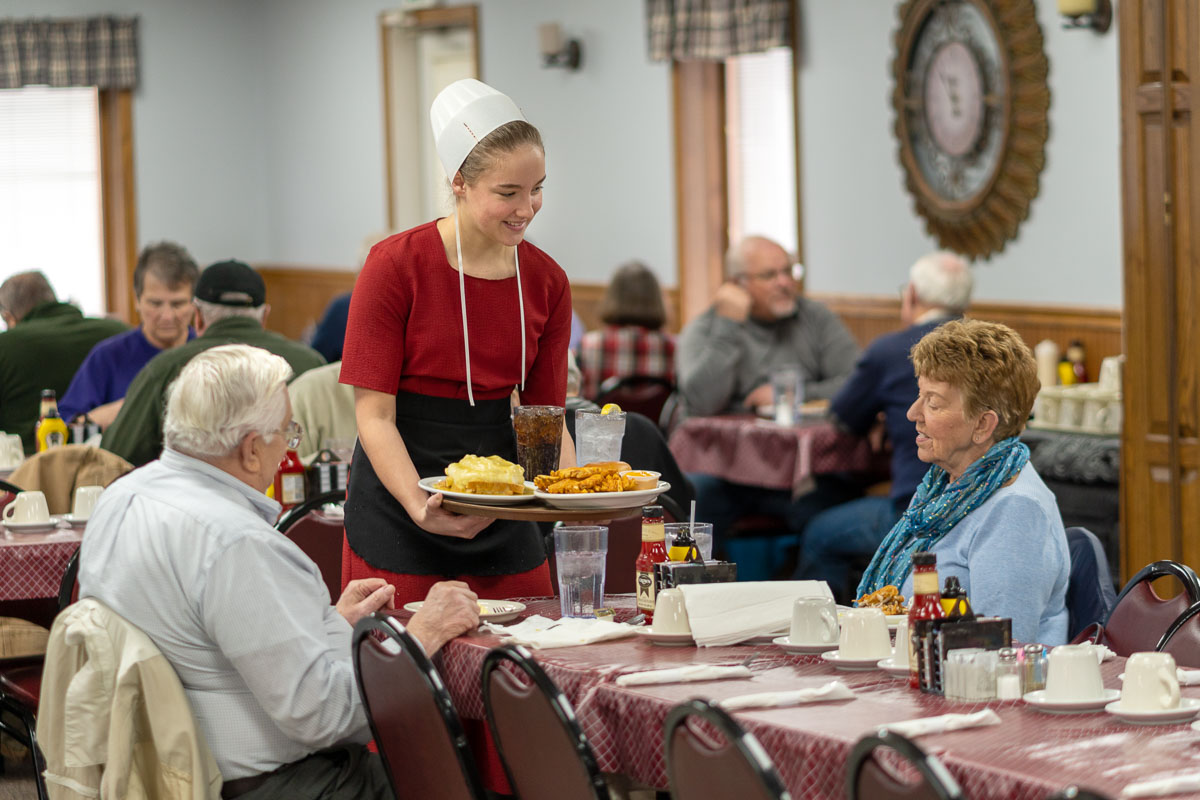 An Amish waitress serves lunch at Tiffany's Restaurant in Topeka, Indiana.