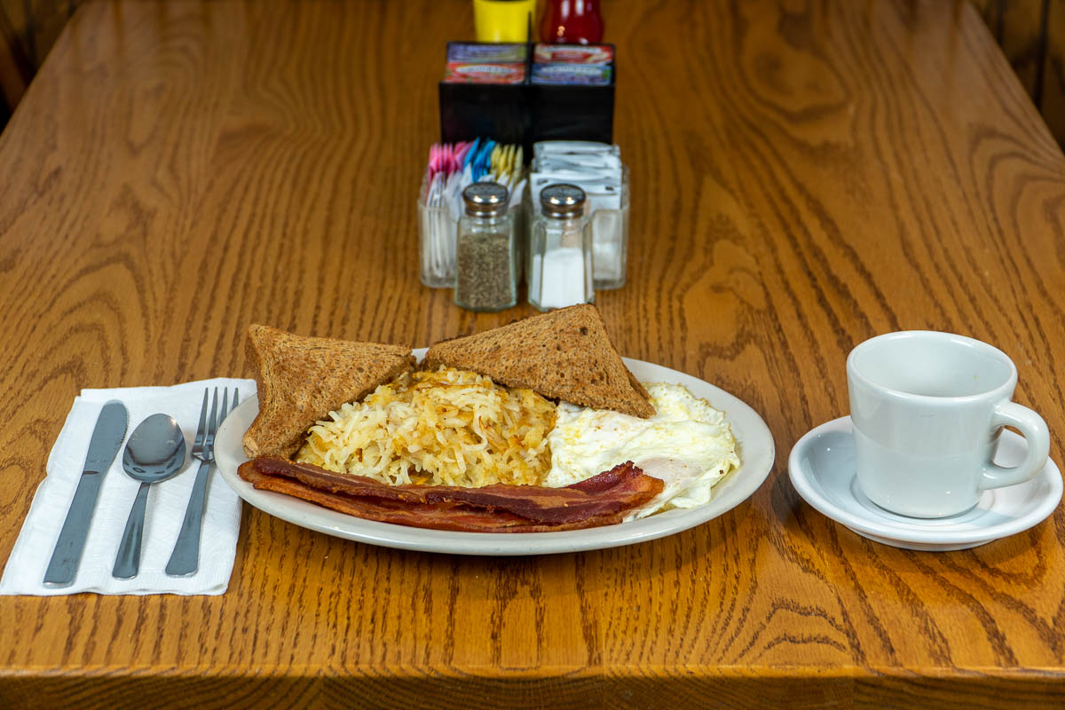 Fried eggs, bacon, hash browns, and toast at Tiffany's Restaurant in Topeka, Indiana.