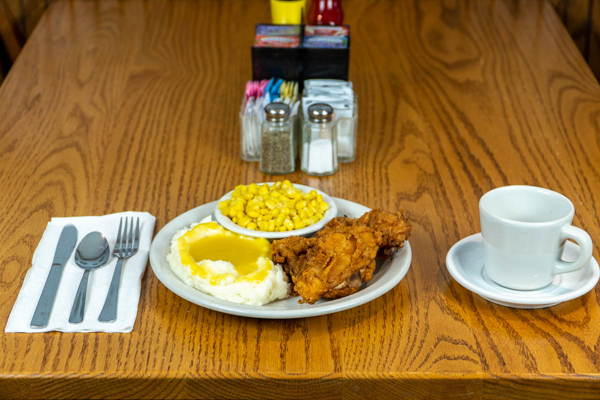 Fried chicken, mashed potatoes and gravy, and corn at Tiffany's Restaurant in Topeka, Indiana.