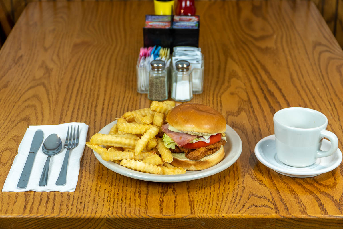 A ham and breaded chicken sandwich at Tiffany's Restaurant in Topeka, Indiana.