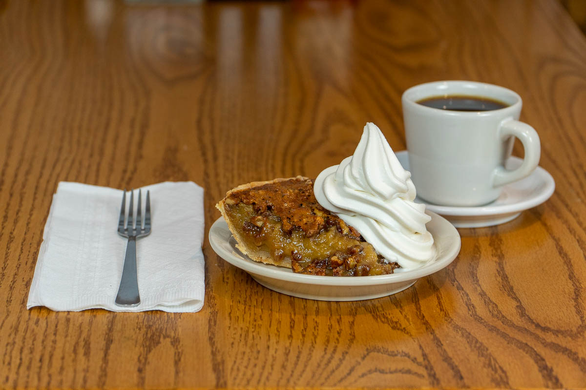 Pecan pie with soft-serve ice cream and a cup of coffee at Tiffany's Restaurant in Topeka, Indiana